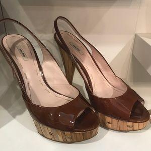 Miu Miu brown patent and cork pumps